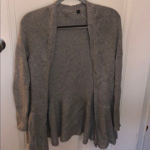 Simple gray cardigan sweater with flair at bottom